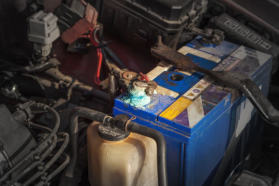 why do car batteries corrode