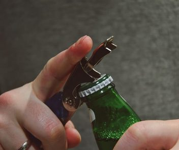 how to open a bottle with a can opener